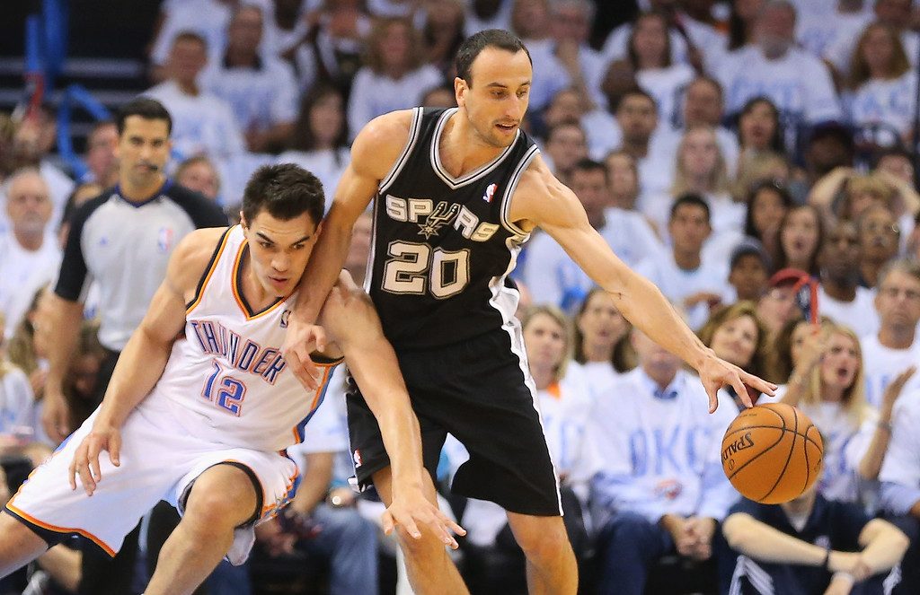 . OKLAHOMA CITY, OK - MAY 31:  Manu Ginobili #20 of the San Antonio Spurs drives with the ball against Steven Adams #12 of the Oklahoma City Thunder in the first half during Game Six of the Western Conference Finals of the 2014 NBA Playoffs at Chesapeake Energy Arena on May 31, 2014 in Oklahoma City, Oklahoma. (Photo by Ronald Martinez/Getty Images)