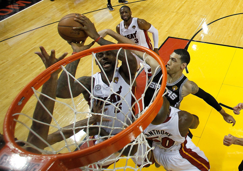 . LeBron James #6 of the Miami Heat goes up for a shot against Danny Green #4 of the San Antonio Spurs in the first half during Game One of the 2013 NBA Finals at AmericanAirlines Arena on June 6, 2013 in Miami, Florida. (Photo by Mike Segar/Pool/Getty Images)