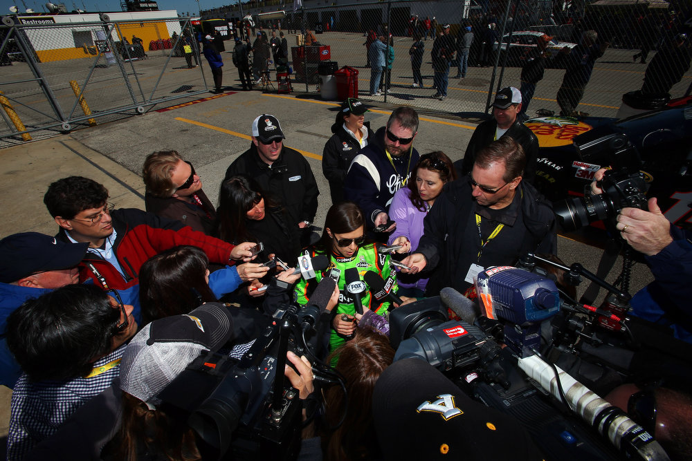 Description of . Danica Patrick, driver of the #10 GoDaddy.com Chevrolet, speaks to the media after qualifying for the NASCAR Sprint Cup Series Daytona 500 at Daytona International Speedway on February 17, 2013 in Daytona Beach, Florida.  (Photo by Jonathan Ferrey/Getty Images)