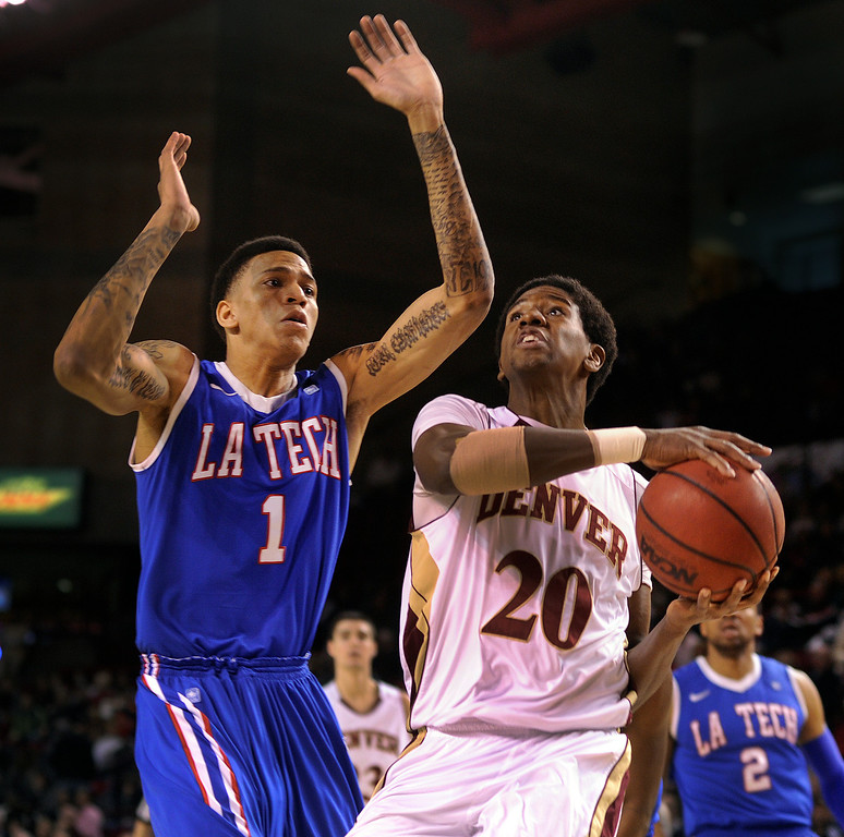 . Pioneers forward Royce O\'Neale (20) made a move to get past Bulldogs forward Michale Kyser (1) in the first half. The University of Denver men\'s basketball team hosted the Louisiana Tech Bulldogs at Magness Arena Saturday night, March 9, 2013. (Photo By Karl Gehring/The Denver Post)