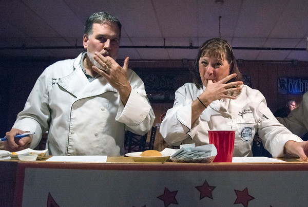 11/19/19 Wesley Bunnell | StaffrrJudges Gary Brummett, L, a retired chef and Lise Jaeger from Chef for Hire LLC lick their fingers after sampling wings during the Southington Chamber of Commerce's annual WingFest at the Cadillac Ranch on Monday night November 18 , 2019.