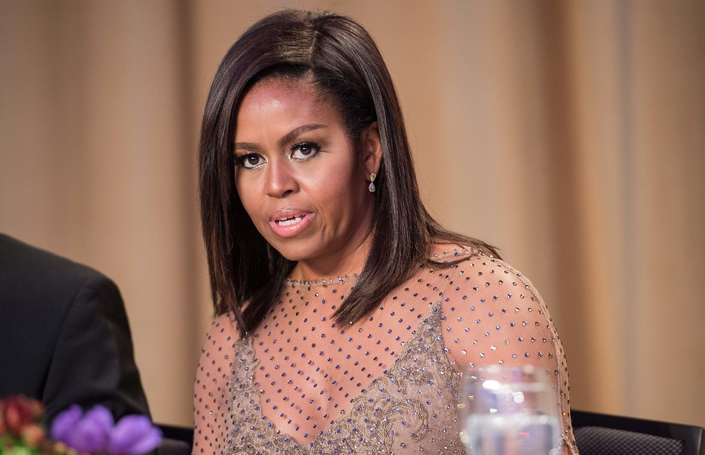 . US First Lady Michelle Obama attends the 102nd White House Correspondents\' Association Dinner in Washington, DC, on April 30, 2016. / AFP PHOTO / NICHOLAS KAMM/AFP/Getty Images
