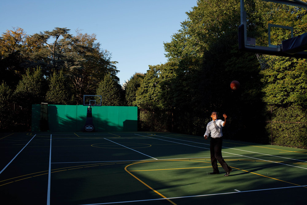 ". Oct. 13, 2010 ""After a day filled with meetings, the President headed to the White House basketball court to shoot a few baskets with his personal aide Reggie Love. Before heading back to the Oval, he flipped the ball towards the rim just where the afternoon light was falling.\"" (Official White House Photo by Pete Souza)"