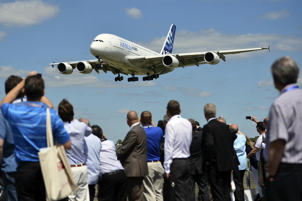 . An Airbus A380-800 prepares to land during a flight demonstration at the Farnborough Airshow in Hampshire, southern England, on July 14, 2014. European planemaker Airbus on Monday launched the eagerly-awaited upgrade of its long-haul A330 passenger jet -- the A330neo -- to meet rising demand for cheaper, more fuel-efficient travel.  AFP PHOTO / CARL COURT/AFP/Getty Images