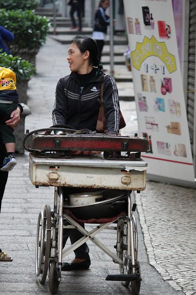 A Wheelchair full of stuff, Senado Square, Macau