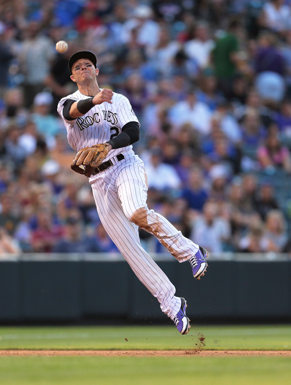 . Colorado Rockies shortstop Troy Tulowitzki throws to first to put out Chicago Cubs\' Welington Castillo in the fourth inning of a baseball game in Denver, Friday, July 19, 2013. (AP Photo/Joe Mahoney)
