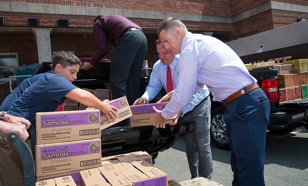 08/14/19 Wesley Bunnell | Staff Congressional candidate John Cain, 4th L, along with senate candidate Robert F. Hyde, R, and congressional candidate Justin Anderson, rear, all help unload Girl Scout cookies from Anderson's truck at the Newington VA on Wednesday August 14, 2019. The trio , through donations from the Girl Scouts, delivered over three thousand boxes of cookies to their fellow veterans.