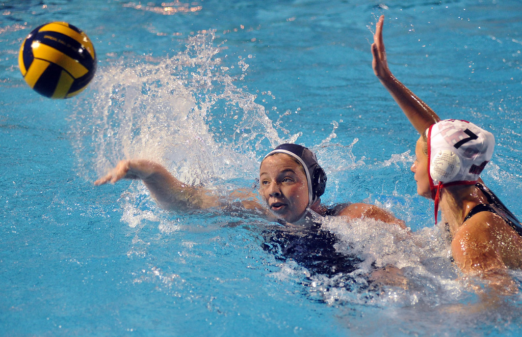 . Crescenta Valley\'s Ashley Taylor (#13) tosses in a goal under pressure from Redlands East Valley\'s Allison Wieseler (#7) in the Southern Section Div. V semifinals girls game water polo at Whittier College\'s Lillian Slade Aquatics Center on Wednesday February 20, 2013. Crescenta Valley beat Redlands East Valley 14-4. (Staff photo by Keith Durflinger)