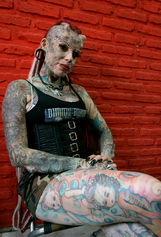 . Maria Jose Cristerna, a mother of four, tattoo artist and former lawyer, poses for a photograph in Guadalajara March 8, 2012. REUTERS/Alejandro Acosta