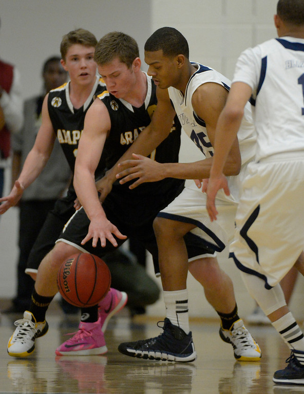 . AURORA, CO - FEBRUARY 12:  Arapahoe Ethan Brunhofer (11) knocks the ball away from King Grant- Perry (45) during their 5A basketball game February 12, 2014 in Aurora. (Photo by John Leyba/The Denver Post)