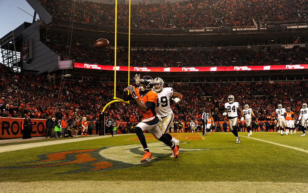 . DENVER, CO - DECEMBER 28: Emmanuel Sanders (10) of the Denver Broncos can\'t reach the pass in the end zone. The Denver Broncos played the Oakland Raiders at Sports Authority Field at Mile High on December 28, 2014. (Photo by AAron Ontiveroz/The Denver Post)