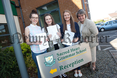Sacred Heart Principal Sr Julie McGoldrick is pictured with Jessica Byrne, Naimh Kitson and Dearbhla Quinn who attained 10A* grades at GCSE. R1535017