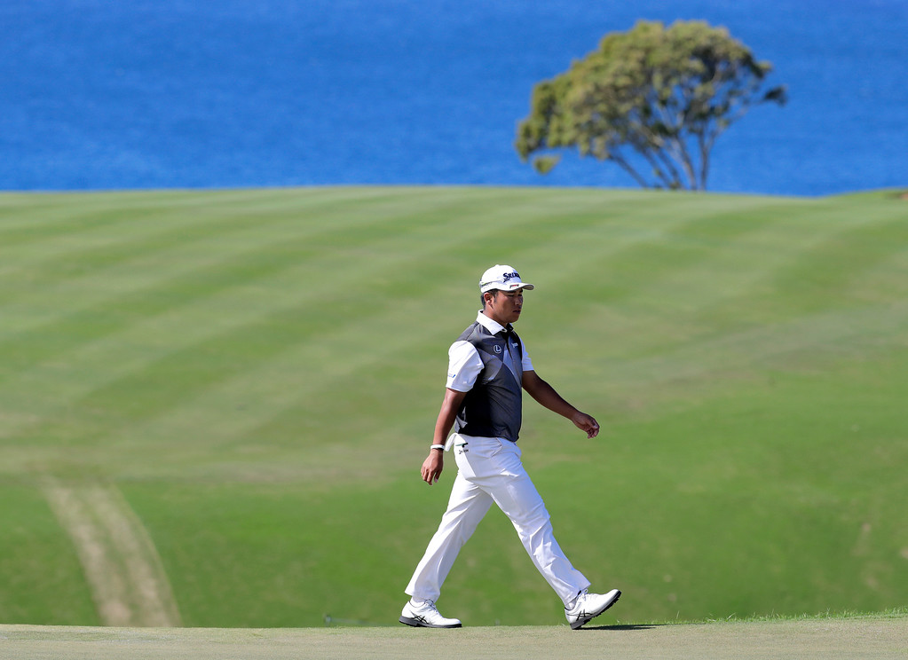 . Hideki Matsuyama, of Japan, walks to the 13th green during the final round of the Tournament of Champions golf event, Sunday, Jan. 8, 2017, at Kapalua Plantation Course in Kapalua, Hawaii. (AP Photo/Matt York)