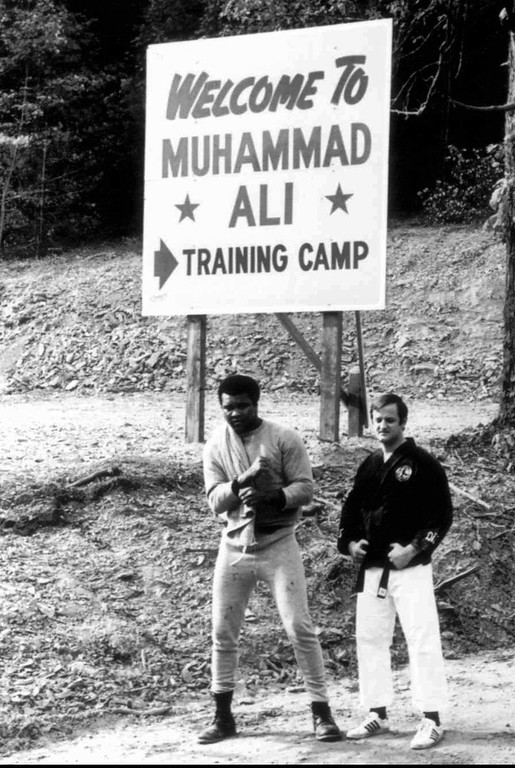 . Boxer Muhammad Ali, left, stands with Karate instructor George Dillman in this 1971 file photo at Ali\'s training camp in Deer Lake, Pa. Dillman has purchased the six acre parcel that Ali called \'Fighters Haven\' and is turning it into a bed and breakfast.(AP Photo/Kim Dillman)