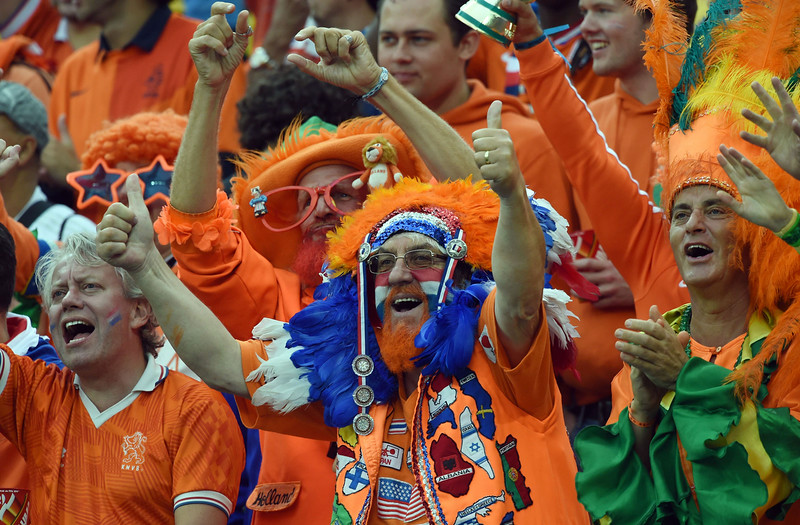 . Netherlands supporters cheer ahead of the semi-final football match between Netherlands and Argentina of the FIFA World Cup at The Corinthians Arena in Sao Paulo on July 9, 2014. (PEDRO UGARTE/AFP/Getty Images)