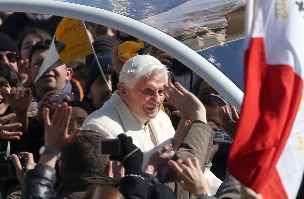 Description of . Pope Benedict XVI waves to the faithful as he arrives in St. Peter\'s Square for his final general audience on February 27, 2013 in Vatican City, Vatican. The Pontiff attended his last weekly public audience before stepping down tomorrow. Pope Benedict XVI has been the leader of the Catholic Church for eight years and is the first Pope to retire since 1415. He cites ailing health as his reason for retirement and will spend the rest of his life in solitude away from public engagements.  (Photo by Franco Origlia/Getty Images)