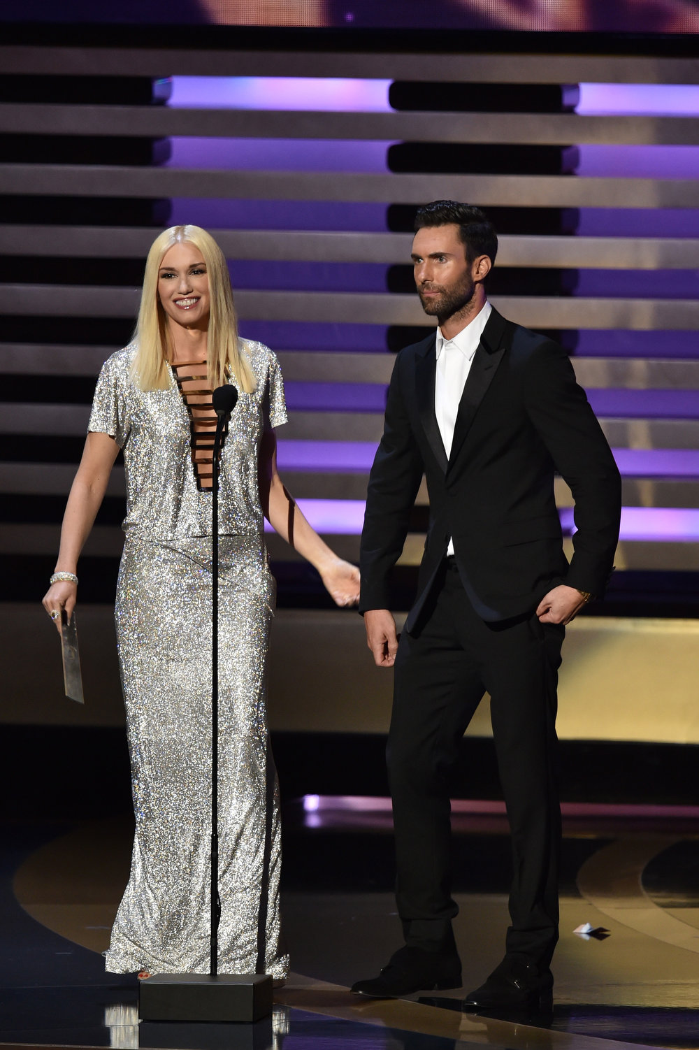 . Singer Gwen Stefani and singer/TV personality Adam Levine speak onstage at the 66th Annual Primetime Emmy Awards held at Nokia Theatre L.A. Live on August 25, 2014 in Los Angeles, California.  (Photo by Kevin Winter/Getty Images)