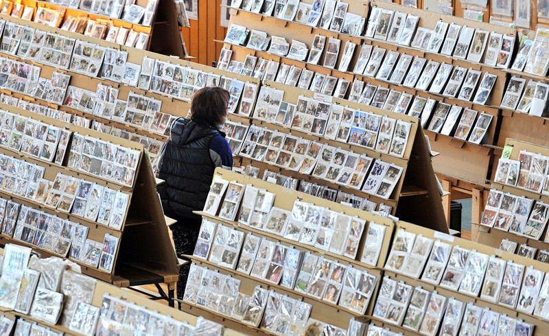 . A visitor looks at pictures discovered in Sendai city after the 2011 earthquake and tsunami disaster at a gymnasium in Sendai, Miyagi Prefecture on March 11, 2014. About 170,000 pictures will be displayed until March 16. Japan marked the third anniversary of the quake-tsunami disaster, which swept away 18,000 victims, destroyed coastal communities, and sparked a nuclear emergency that forced a re-think on atomic power.  (KAZUHIRO NOGI/AFP/Getty Images)