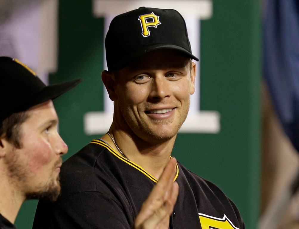 . New Pittsburgh Pirates\' Justin Morneau, right, talks with Travis Snider in the dugout after arriving during the sixth inning of their game against the St. Louis Cardinals in Pittsburgh on Saturday, August 31, 2013. The Pirates won 7-1. (AP Photo/Gene J. Puskar)