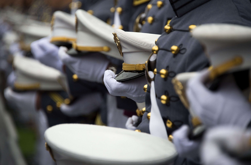 . Members of the graduating class hold their covers as US President Barack Obama delivers the commencement address at the United States Military Academy at West Point, New York on May 28, 2014.  (JIM WATSON/AFP/Getty Images)