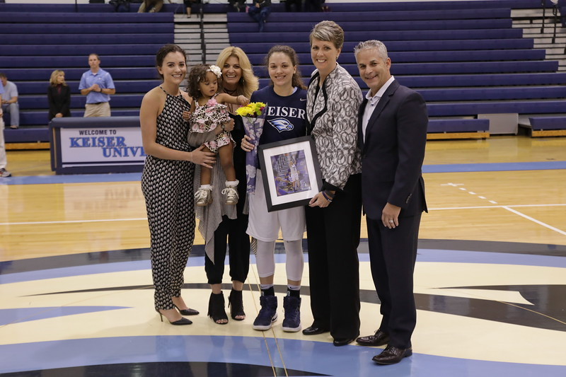 Keiser senior Hannah Del Negrol with family and Coach Oswald