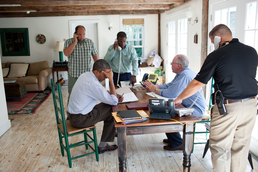 ". Aug. 26, 2011 ""A former President once said, \'Presidents don\'t get vacations, they just get a change of scenery.\'  We were on \'vacation\' in Martha\'s Vineyard and the President was monitoring Hurricane Irene with John Brennan, Assistant to the President for Homeland Security and Counterterrorism, at right in light blue shirt. They were waiting for a conference call on the hurricane with affected governors and mayors.\"" (Official White House Photo by Pete Souza)"