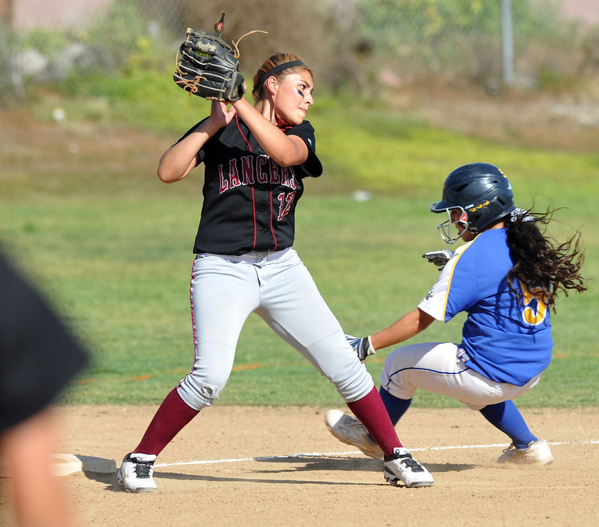 . California\'s Chloe Michery (#5) avoids a tag as she steals third base while playing Bell Gardens in their non-league game at California High School in Whittier on Thursday March 14, 2013. California beat Bell Gardens 10-0 in five innings. (SGVN/Staff Photo by Keith Durflinger)