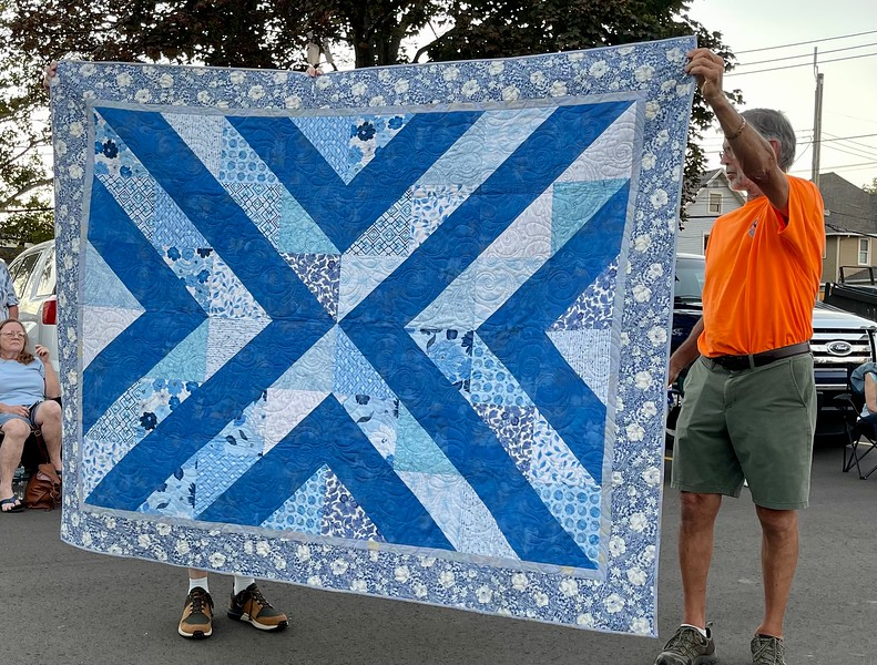 """John Putnam made this """"Birdie"""".  a pattern by Running Doe quilts.  The outer border fabric was an estate sale purchase that had a receipt from a PX in Japan dated 1973 and the fabric was 50 cents a yard."""