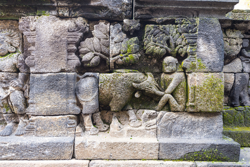 Some of the rocks had been replaced during the restoration process. Bufallo and monkey are in this relief.