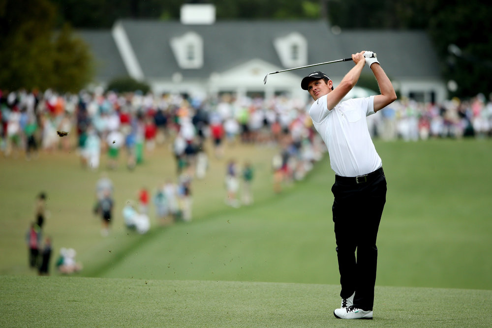 Description of . Justin Rose of England hits his second shot on the first hole during the final round of the 2013 Masters Tournament at Augusta National Golf Club on April 14, 2013 in Augusta, Georgia.  (Photo by Andrew Redington/Getty Images)
