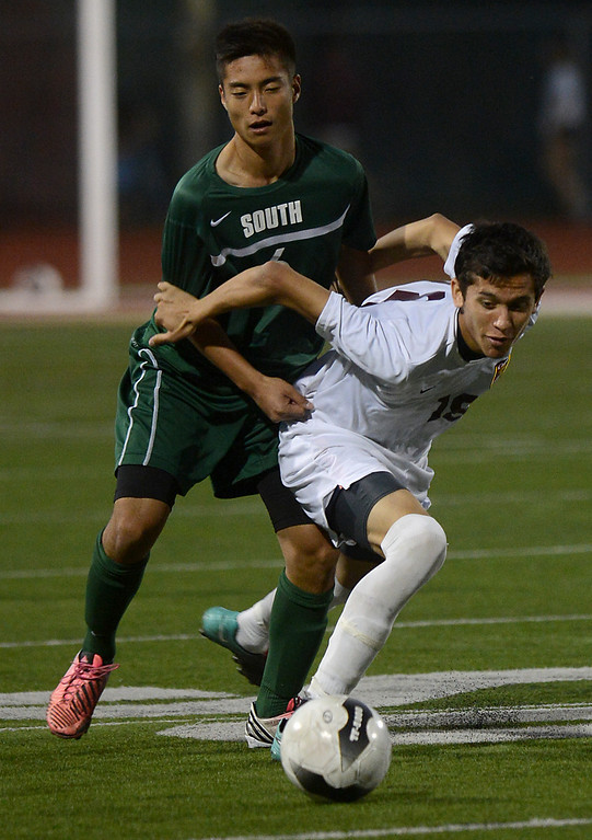 . Ontario (white) vs South Torrance (green) CIF-SS boys soccer Division 4 championship game action Friday, March 1, 2013, at Corona High School in Corona. Ontario defeated South Torrance 3-2 in overtime to take the title, which is the school\'s first CIF soccer title and only second sports title in school history. Jennifer Cappuccio Maher/Staff Photographer