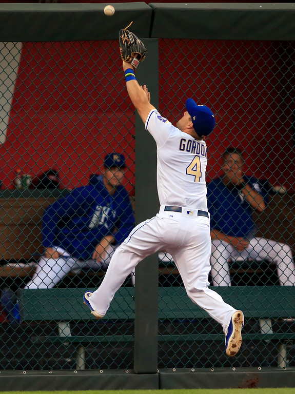 . Kansas City Royals left fielder Alex Gordon chases a double hit by Cleveland Indians\' Yan Gomes during the fifth inning of a baseball game at Kauffman Stadium in Kansas City, Mo., Friday, June 2, 2017. (AP Photo/Orlin Wagner)