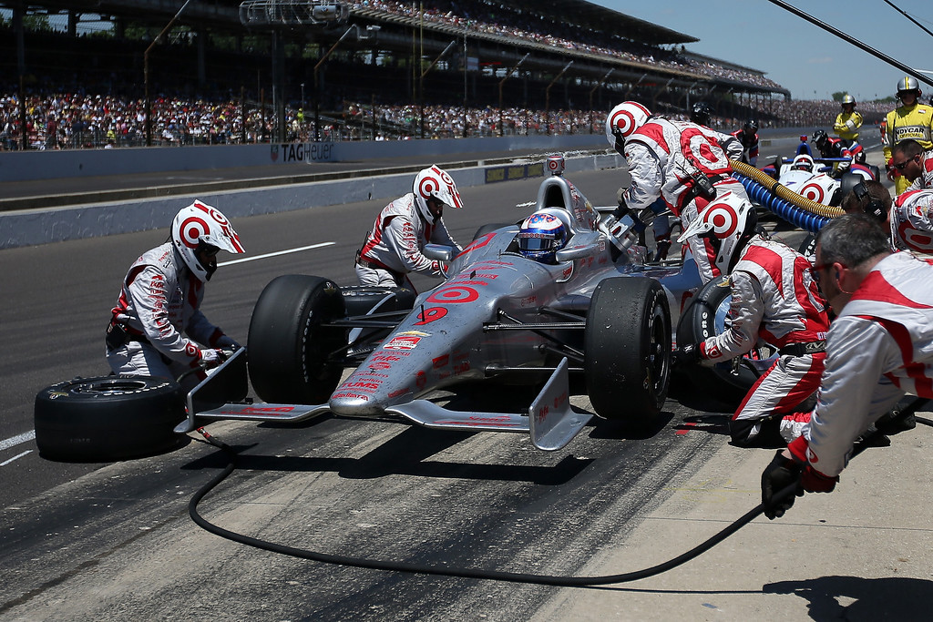 . Scott Dixon of New Zealand, driver of the #9 Target Chip Ganassi Racing Chevrolet Dallara, pits during the 98th running of the Indianapolis 500 Mile Race at Indianapolis Motorspeedway on May 25, 2014 in Indianapolis, Indiana.  (Photo by Chris Graythen/Getty Images)