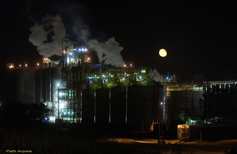 Moon over ethanol plant somewhere side of the freeway, Iowa