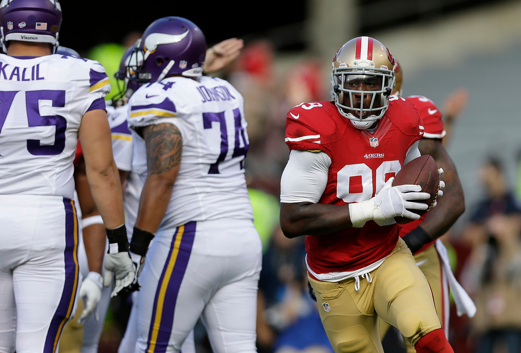 . San Francisco 49ers linebacker Aldon Smith, right, celebrates after recovering a fumble by Vikings quarterback Christian Ponder during the first quarter. (AP Photo/Marcio Jose Sanchez)