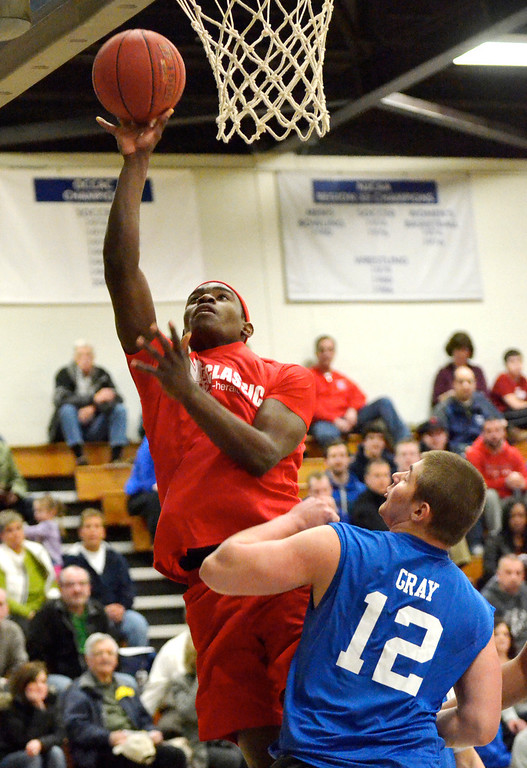. Jeff Forman/JForman@News-Herald.com Deandre Forte, Red Team, shoots over Andrew Gray during the 36th News-Herald Classic March 29 at Lakeland Community College.