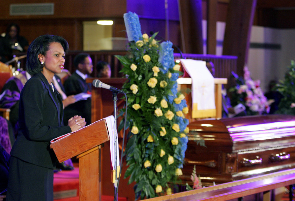 Description of . Secretary of State Condoleezza Rice speaks as the casket of civil rights icon Rosa Parks lies at St. Paul A.M.E. Church Sunday Oct. 30, 2005 in Montgomery, Ala. The church held a memorial service for the 92-year-old Tuskegee native who died at her home in Detroit earlier in the week. (AP Photo/Rob Carr)