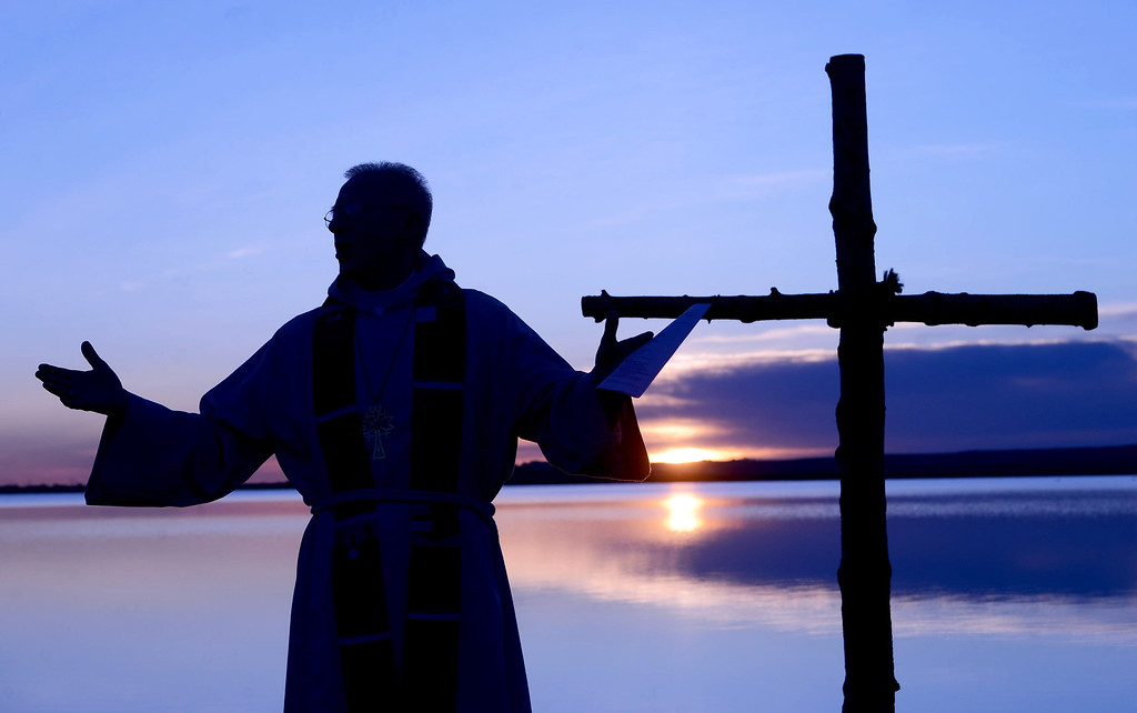 . Rev. Mark Twietmeyer, of Trinity Lutheran Church, gives his part of the Easter sermon at the Boulder Reservoir on Sunday, April 20, 2014, in Boulder, Colo. (AP Photo/The Daily Camera, Cliff Grassmick)