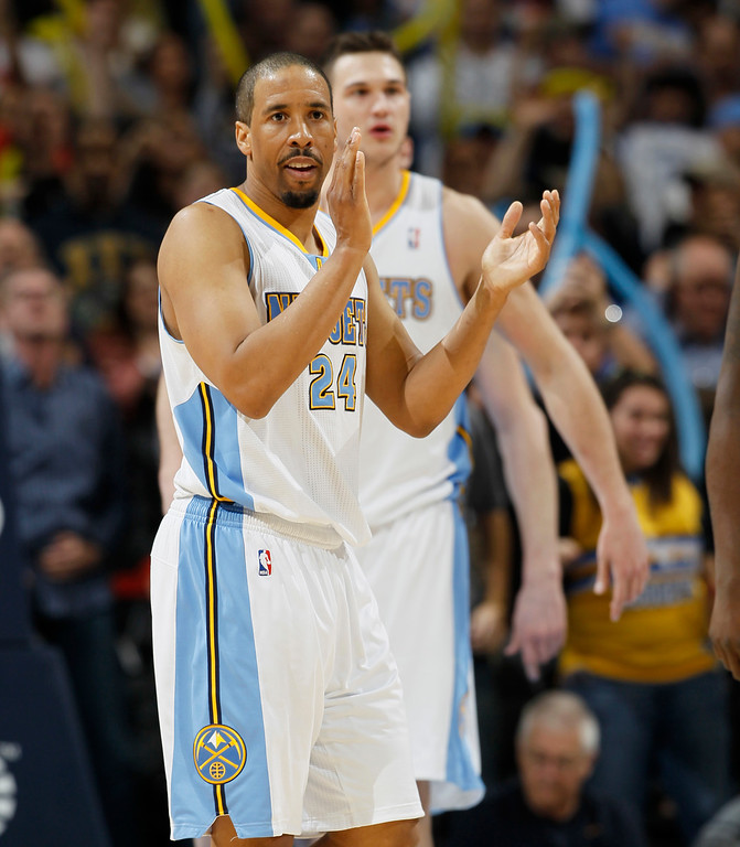 . Denver Nuggets guard Andre Miller, front, joins forward Danilo Gallinari, of Italy, in celebrating as time runs out in the fourth quarter of the Nuggets\' 87-80 victory over the Memphis Grizzlies in an NBA basketball game in Denver on Friday, March 15, 2013. (AP Photo/David Zalubowski)