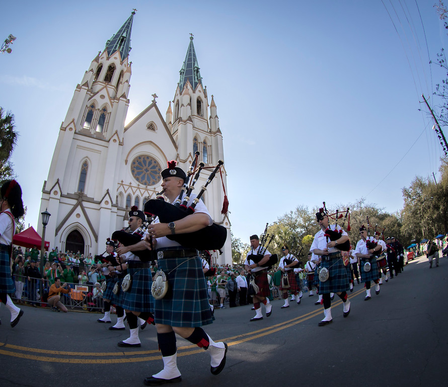 . Members of the Dublin Fire Brigade Pipe Band perform while marching past The Cathedral of St. John The Baptist during the St. Patrick\'s Day parade, Tuesday, March 17, 2015, in Savannah, Ga. The St. Patrick�s Day tradition in Savannah dates back to the first parade held on March 17, 1824. (AP Photo/Stephen B. Morton)