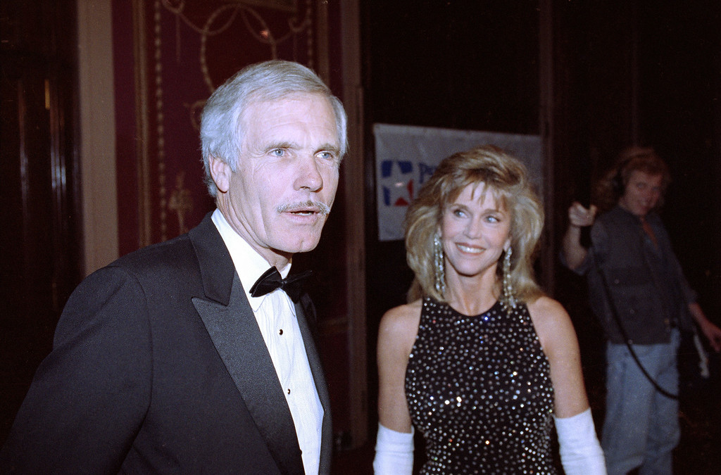 ". 1991: Ted Turner. Actress Jane Fonda, right, waits for Ted Turner as he talks to reporters in New York, Nov. 20, 1991. Turner received the ""Spirit of Liberty\"" award from People for the American Way for his work in expanding the scope of freedom of the press around the world. (AP Photo/Mark Lennihan)"