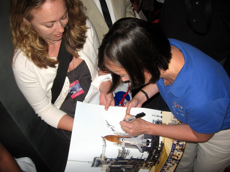 STS-125 Mission Specialist 3 Megan McArthur autographs a photo Heather took the day before the launch