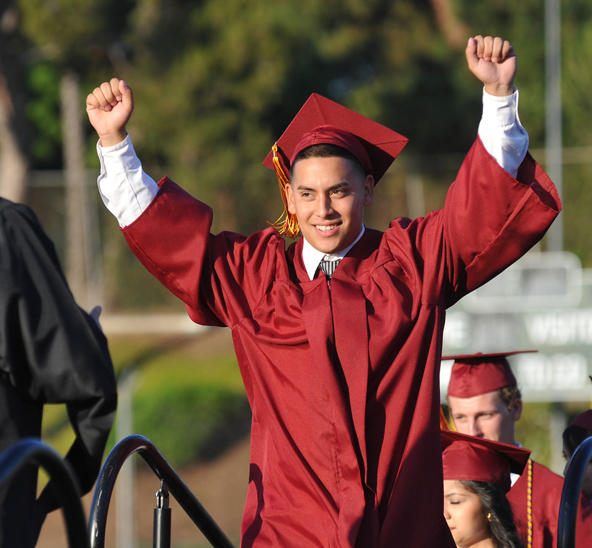. Moises Jimenez reacts as his name is called during La Serna High School\'s 51st Annual Commencement at La Mirada High School stadium in La Mirada on Thursday June 13, 2013. La Serna marked the commencement of 635 graduates and marking Principal Ann Fitzgerald\'s first graduation as principal. (SGVN/Staff Photo by Keith Durflinger)