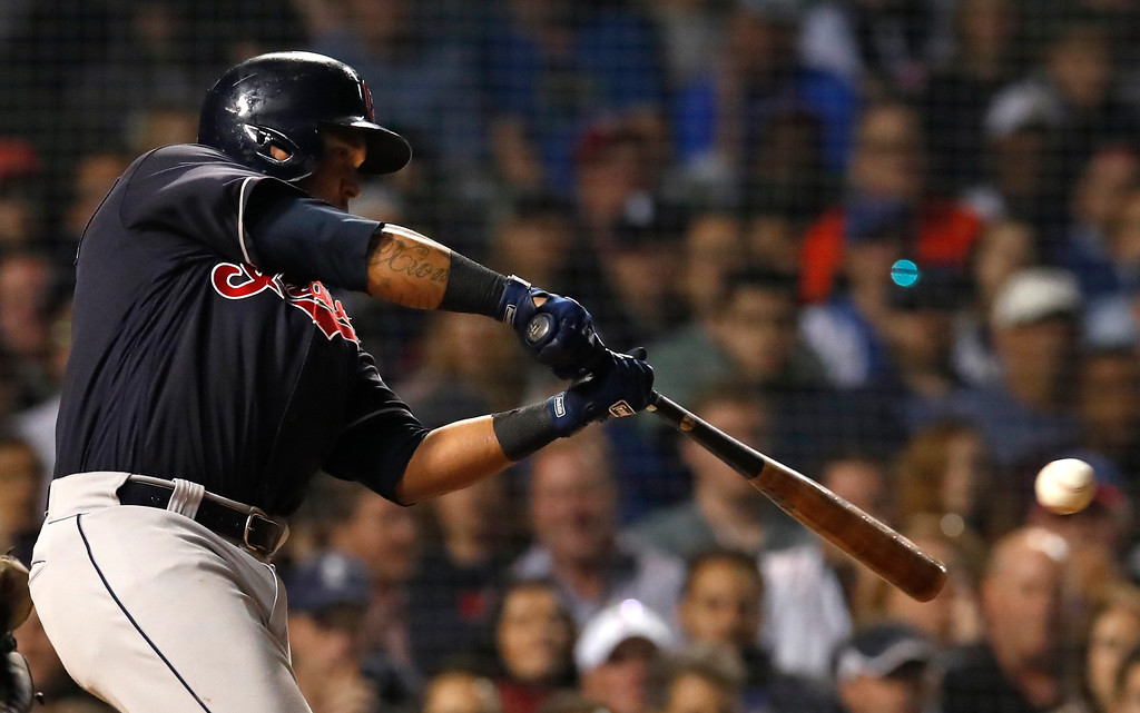 . Cleveland Indians\' Jose Ramirez hits a single during the eighth inning of the team\'s baseball game against the Chicago Cubs on Wednesday, May 23, 2018, in Chicago. (AP Photo/Jim Young)