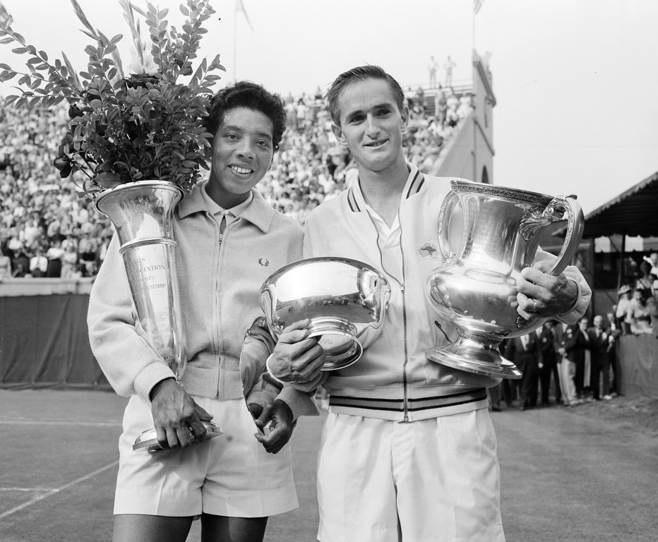. Althea Gibson, left, and Mal Anderson hold their trophies after their victories in the National Tennis Championships in Forest Hills, N.Y., Sept. 8, 1957.  (AP Photo/Harry Harris)