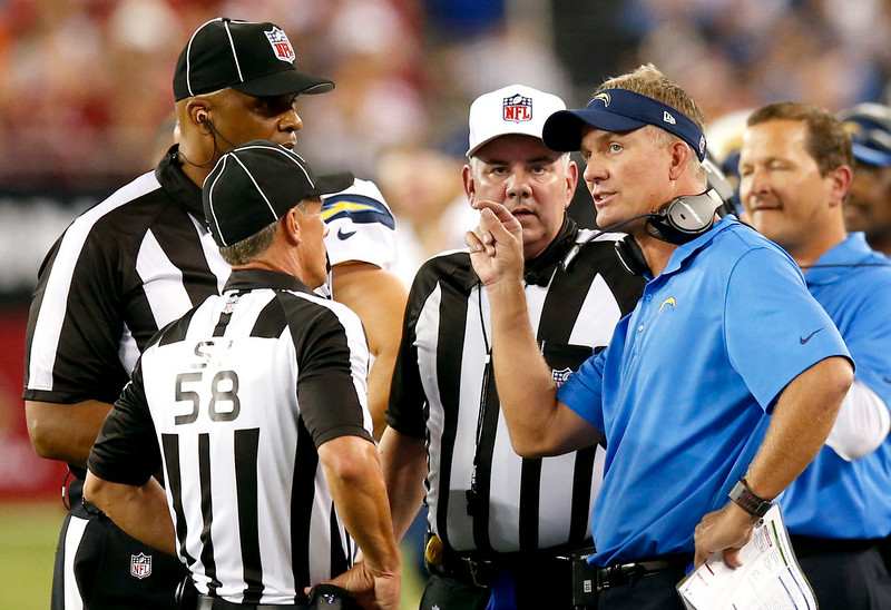 . San Diego Chargers head coach Mike McCoy challenges a fumble on the field during the first half of an NFL football game against the Arizona Cardinals, Monday, Sept. 8, 2014, in Glendale, Ariz. The Chargers won the challenge and recovered the fumble. (AP Photo/Ross D. Franklin)