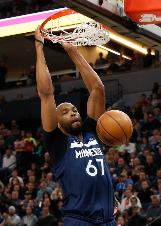 . Minnesota Timberwolves\' Taj Gibson dunks against the Cleveland Cavaliers in the first half of an NBA basketball game Monday, Jan. 8, 2018, in Minneapolis. (AP Photo/Jim Mone)