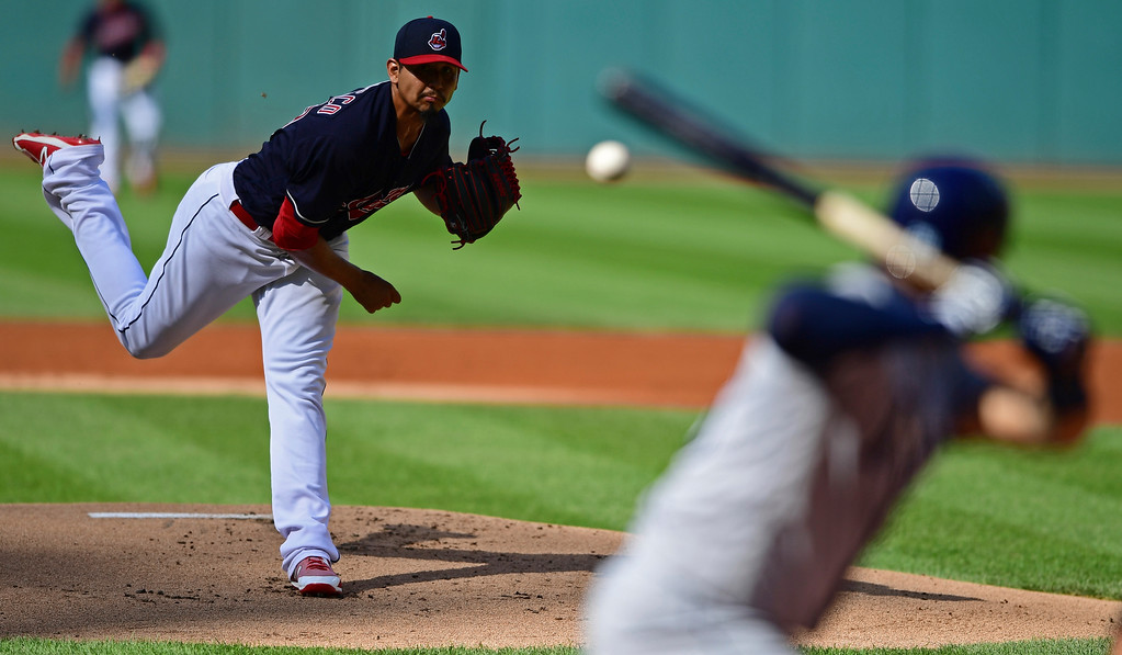 . Cleveland Indians starting pitcher Carlos Carrasco delivers to Tampa Bay Rays\' Tommy Pham in the first inning of a baseball game, Sunday, Sept. 2, 2018, in Cleveland. (AP Photo/David Dermer)