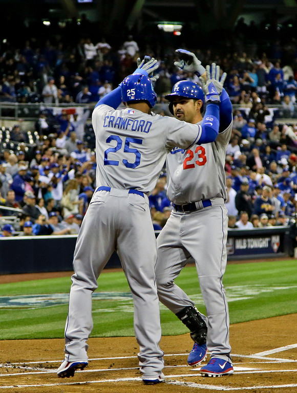 . Los Angeles Dodgers\' Adrian Gonzalez is congratulated by teammate Carl Crawford after his two-run homer against the San Diego Padres during the first inning of baseball game in San Diego, Thursday, April 11, 2013. (AP Photo/Lenny Ignelzi)