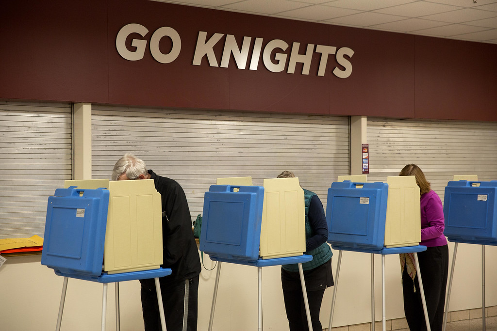 . Voters cast their ballots in the midterm elections at Bellarmine University November 4, 2014 in Louisville, Kentucky. Americans head to the polls to cast their vote which will decide whether Republicans or Democrats will control the Senate. (Photo by Aaron P. Bernstein/Getty Images)